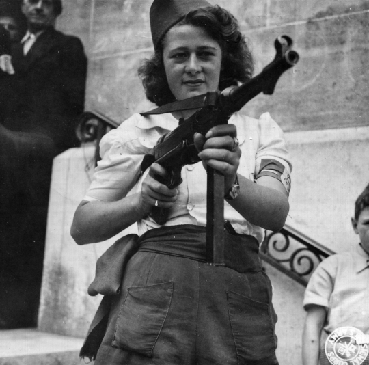 _Nicole__a_French_Partisan_Who_Captured_25_Nazis_in_the_Chartres_Area,_in_Addition_to_Liquidating_Others,_Poses_with..._-_NARA_-_5957431_-_cropped